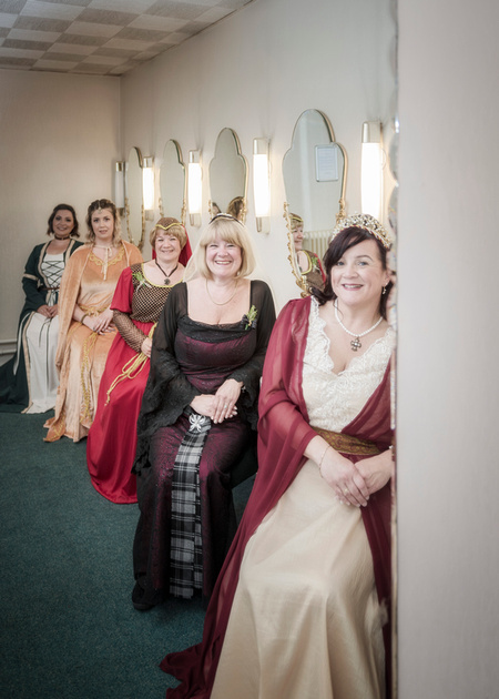 beautiful medieval bride and female guest in the powder room at the masonic hall preston reflection in mirror shot