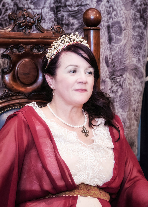 medieval bride having a quiet moment and looking very serene at the masonic hall preston