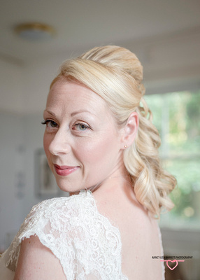 beautiful burnley bride looking over her shoulder with hair and make up finished