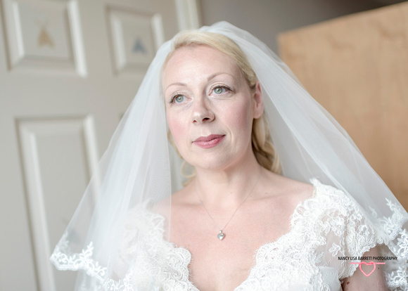 stunning bride thinking about her forthcoming marriage at towneley hall burnley lancashire
