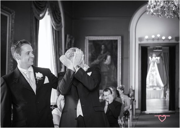 best man with groom who is crying with nerves in towneley hall burnley