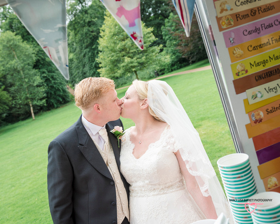 bride and groom kissing at hyacinth vintage ice cream at towneley hall gardens burnley lancashire