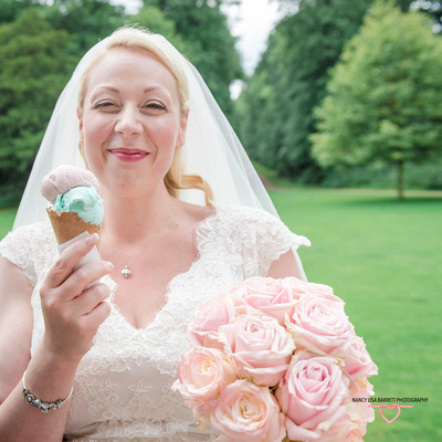 the bride smiling and holding flowers and cornet at hyacinth vintage ice cream at towneley hall gardens burnley lancashire