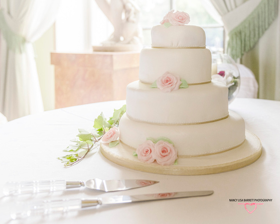 beautiful wedding cake four tiers light window pastel colours towneley hall reception room burnley