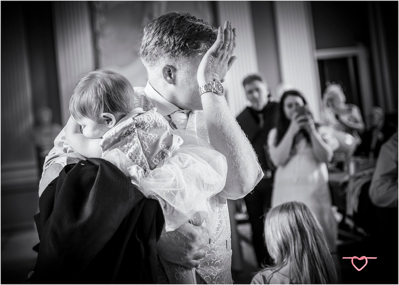 groom overcome with emotion at brides singing to him whilst their daughter sleeps at towneley hall burnley