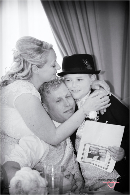 hugs for gooms son from bride and groom after his speech at their wedding at towneley hall burnley