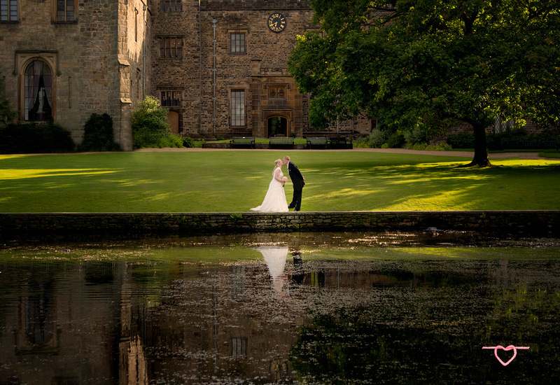 beautiful reflection shot of the bride and groom in front of towneley hall and gardens burnley lancashire