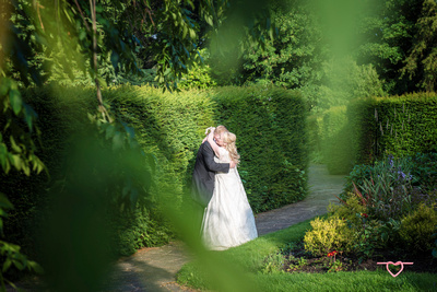 the bride and groom thought i had gone but i crept back and photographed them secretly in towneley hall gardens