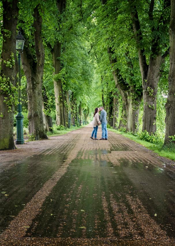 a romantic kiss on avenham miller park in the rain on pre wedding shoot preston