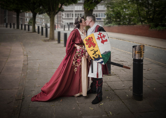 bride and groom preston city centre medieval outfits kiss