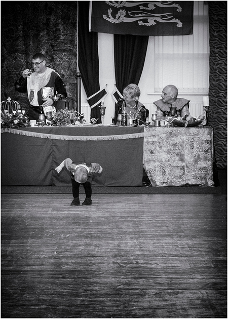 very young medieval lad takes a bow at medieval wedding at masonic hall preston lancashire