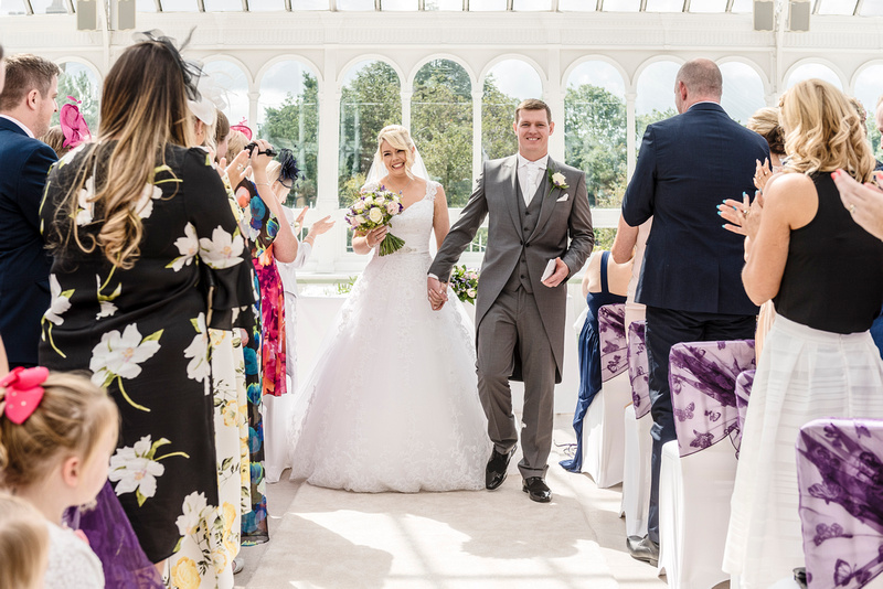 bride and groom just married at the isla gladstone glasshouse in liverpool