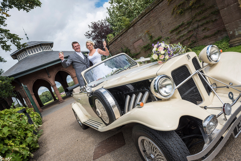 bride and groom stood up in wedding car at the isla gladstone liverpool
